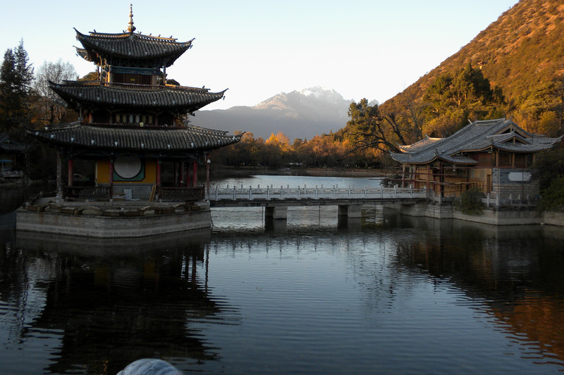 Lijiang (麗江) - Back to lower grounds, we took this photo of the distant Jade Dragon Snow Mountain from a park in Lijiang.