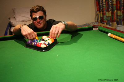 Luke playing pool. Photo by Trent Williams