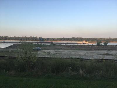Sunset cruise upriver via barge
