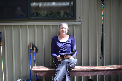 Reading a book while warming up in the sun after a cold water sponge bath and hair washing session at Clinton or Mintaro hut.