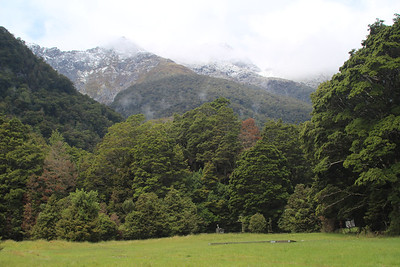 Peaks are in the clouds and it's drizzling as we start the Milford Track.