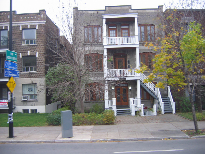 Typical homes and apartments in Montreal. Shows a trend to use outside stairways in those days.