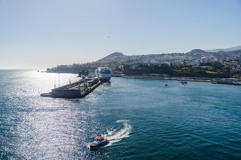 Leaving Funchal, pilot boat following