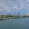 The main channel to the ocean, Miami Beach towers along the ocean