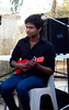 Sam Rayapaty - an ANU employee at the Warramunga Seismic Station. As well as helping keep the field station running Sam also plays the ukulele. here he is in an impromptu concert at the Thursday afternoon ART market in Tennant Creek.