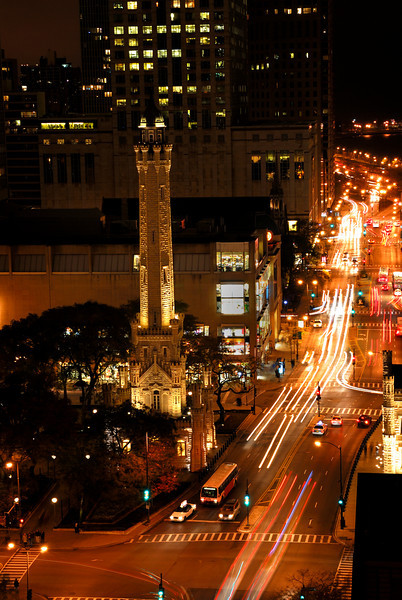 Aerial view of downtown Chicago streets in the evening showing the historic Water Tower that survived the great Chicago Fire.