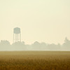 Small town water tower in morning golden light. Atlanta, Indiana.