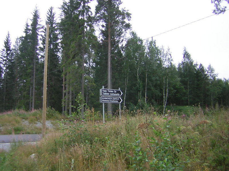 Signs pointing to two different sawmills.