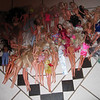 Forty Barbies waiting for attention.