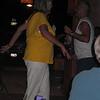 Jim dances, woman interrupts Mark's picture taking.