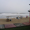 """Vendors set up their beach stands even before the fog has lifted. The """"old man"""" directly off our veranda has been there as long as we have. He sells fish- and shrimp-on-a-stick."""