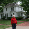 Lynn in front of home