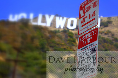 Hollywood sign and no trespassing signs in neighborhood.