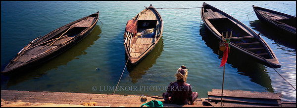 Holy man contemplating on the steps of Ganges River, Varanasi, India.