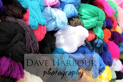 Business. Bright, colorful Yarn for sale in small village market, photo by Dave Harbour