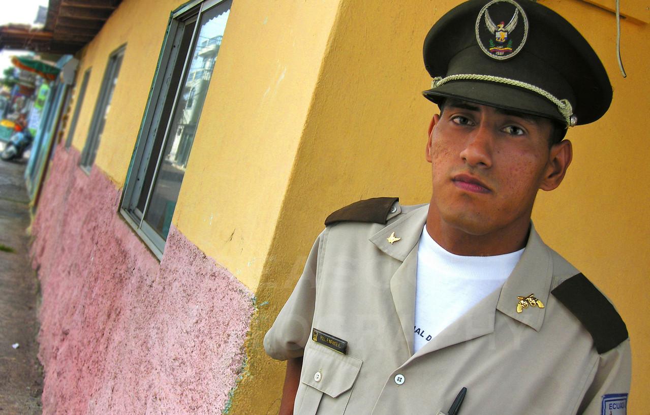 Police officer, San Cristobal, Ecuador.