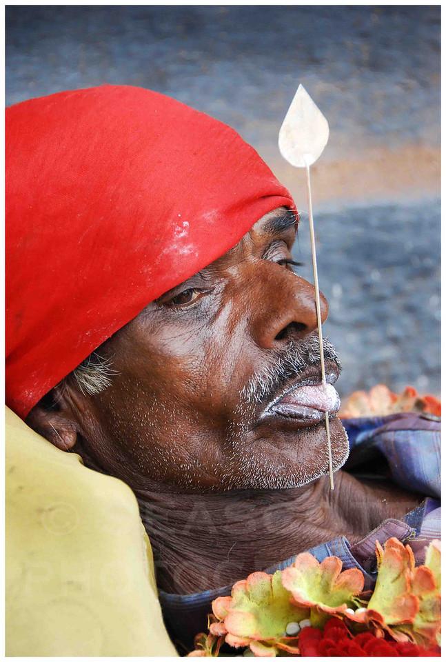 A Hindu alms seeker in Trivandrum, India.