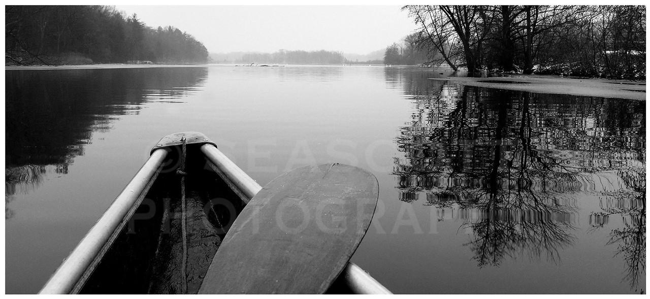 Winter canoeing.    Ann Arbor, Michigan.