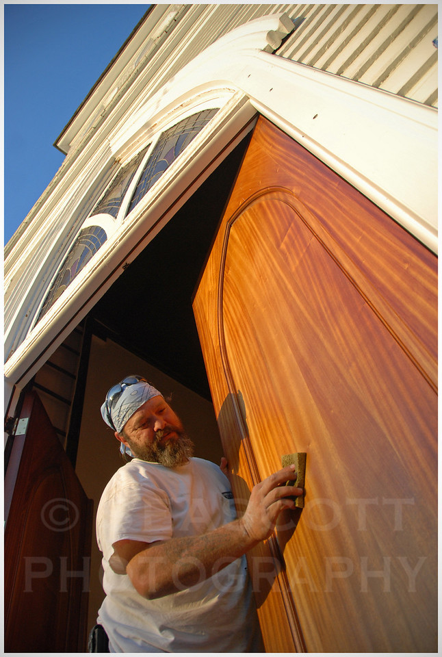 A carpenter refinished the doors to the 1850's era United Methodist Church in Beaufort, NC.