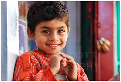 A youngster's shy smile in Ooty, India.