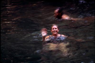 Bobbi swimming in rainforest