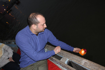 setting candle with ghee adrift as an offering