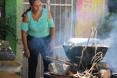 Woman with parrilla in the barrio of Grenada