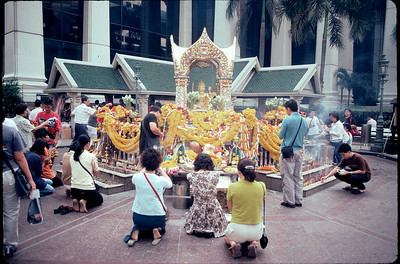 little temple amidst tall buildings in Bangkok