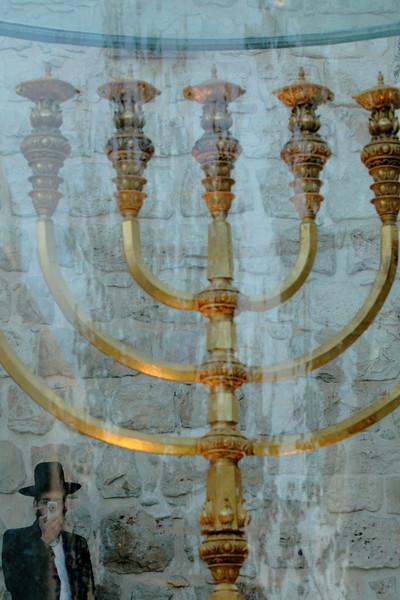 A golden menorah in the Jewish quarter of Old Jerusalem.
