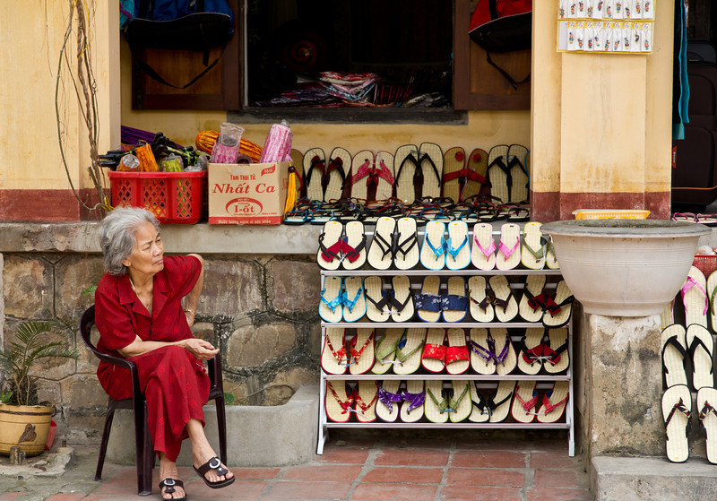 'Lady and the slippers' - An old Vietnamese lady selling summer slippers.