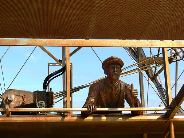 Life-sized bronze sculpture depicting Orville Wright's first flight at Kill Devil Hills, NC