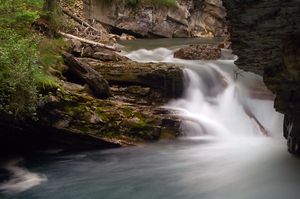 Waterfalls and rushing water captured with a long exposure for motion blur - canyon Rocky Mountain landscape mountains scenic landscape - Photograph by professional nature stock photographer Christina Craft