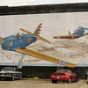 Large mural on a wall in Corsicana, TX.  Seems they had a flight training school here during WWII. The old 1960 Corvair parked there did not look to be in running condition although the tires were not flat.