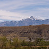 Capitol Reek Utah with snowy mountains in the background