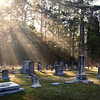 Quiet sunrise over grave stones in an old cemetery
