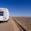 Travel Trailer on a long empty dirt road Oklahoma