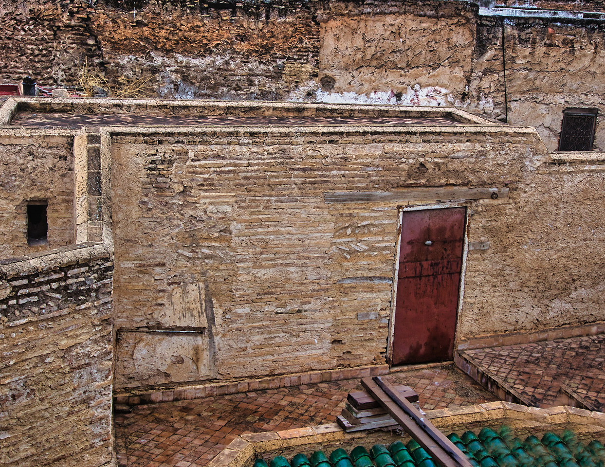 Doorway and wall, deep in the heart of the Fes Medina in Morocco