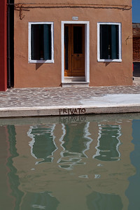 Burano, Venice Colourful canal house in Burano