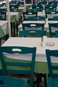 Green cafe Tables and chairs in Fiskardo