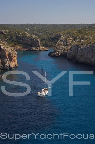 Cala Coves with yacht, Menorca, Balearics
