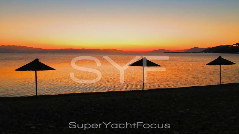 Beach parasols at sunset