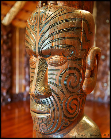 Pillar in the Waitangi Treaty Grounds Meeting house (whare runanga).  I think that the man represented in carving was the one that our Maori guide pointed out as being her grandfather, several generations back.<br /> <br /> Waitangi, NZ<br /> November 16, 2011
