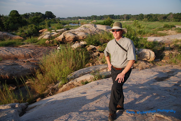 Keith standing in riverbed. No Hippos on this hike to river. The Bridge in the distance is the main enterance to Kruger National Park.