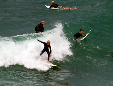Surfers at Monarch Beach near Laguna, CA