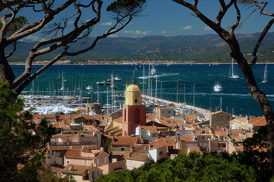 I took this photo from a great vantage point overlooking the town of St. Tropez.  I had to jump a wall in order to frame the photo with the trees but it was a very windy day and there were not many people around.