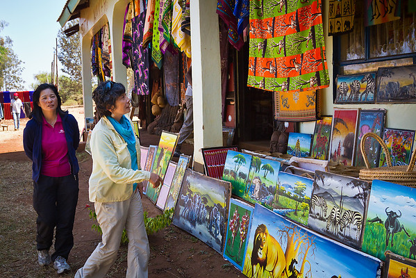 On our way back, the ladies take a good gander at the colourful local art.