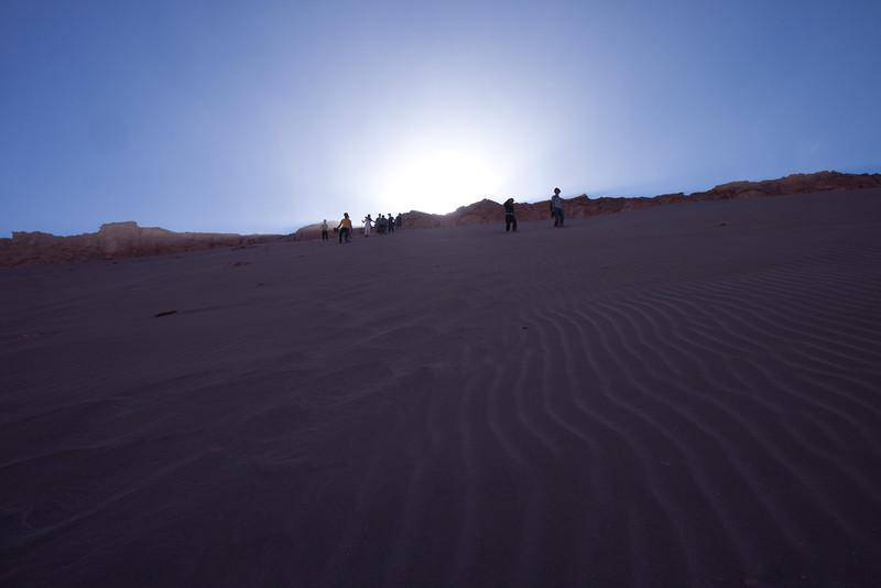 Descending a sand dune.