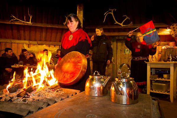 As one of the Sami people beats on the drum, another in the background explains the Sami flag and it's link to the sun (the red/blue circle). Spending several months in so much darkness up in Lapland, it's no surprise that the indiginous people worship the sun.