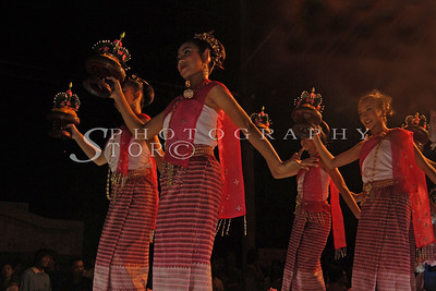 Dancers performing in the Chiang Mai streets parade Lantern Festival