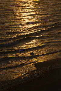 Surfers in the sunset, Monarch Beach